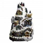 Village de Noël montagne, sapins et maisons enneigées